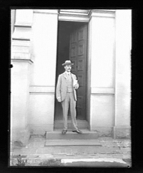 Pietro Baracchi standing at the entrance of the main observatory building, Melbourne Observatory, circa 1900